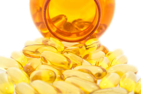 Cod liver oil omega 3 gel capsules isolated on white background photo