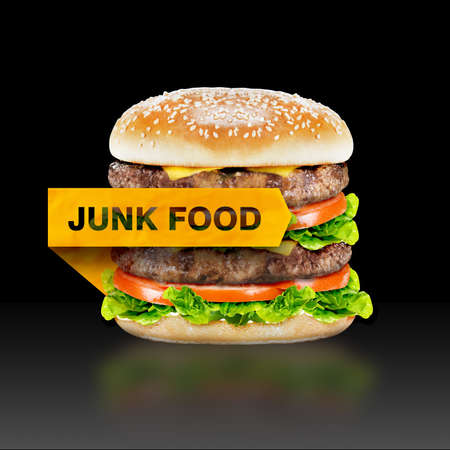 Junk Food, burger with warning message on black background with clipping path. photo