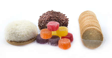 collection of delicious candies, biscuit and Cookies on a white background . photo