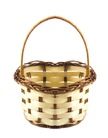 Small empty wicker basket isolated on white background photo