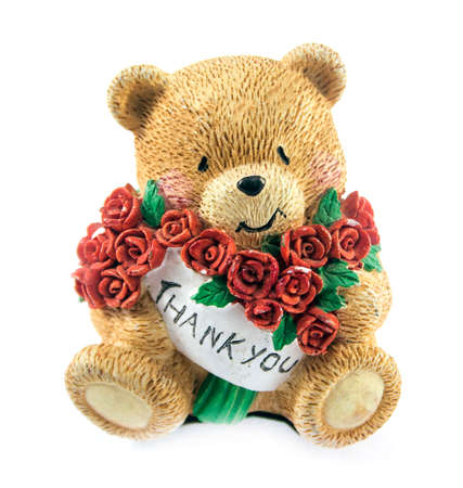 cute teddy bear couple holding red rose. photo