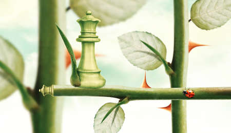 heed: Green Minister Chess on rose stem, Power and Challenge concept. Stock Photo