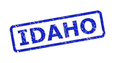 Blue IDAHO watermark on a white background. Flat vector textured watermark with IDAHO title is inside rounded rect frame. Watermark with grunge style.