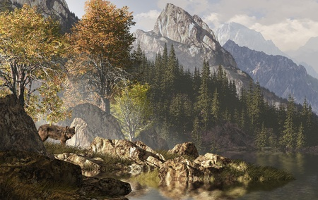 Wolf near a lake in a Rocky Mountain landscape.  photo