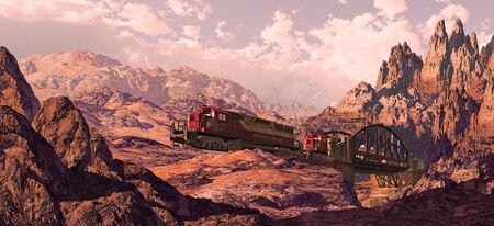 Diesel locomotive crossing bridge over canyon in a Southwest landscape. Stock Photo