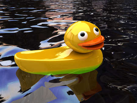 infant bathing: Classic Squeak Toy Rubber Ducky on water Stock Photo
