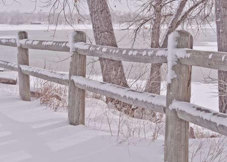 split rail: Snowy Split Rail Fence and Tree By The Icy Lake