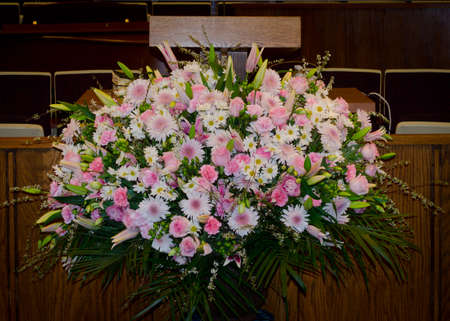 Spring Pulpit Flower Arrangement with Palm Fronds, and Pink White and Lavender Carnations, Lillies, Daisies , Mums, Roses, Lisianthus and Lime Green Hypericum photo