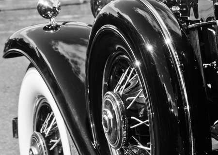 shiny black: Monochrome Wheels and Fender of a Vintage Funeral Coach Stock Photo