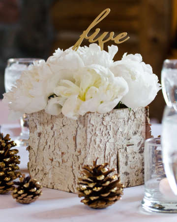 Centerpiece for Table Five with White Peonies in a Birch Box Accented with Glitter Dipped Pine Cones photo