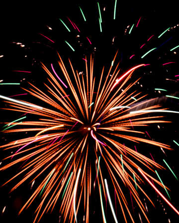 pyro: Red, Orange, White,  Pink Firework Exploding with Green Sparks Stock Photo