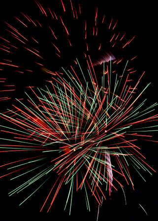 Three Multi-Colored Fireworks Bursting In The Air Stock Photo