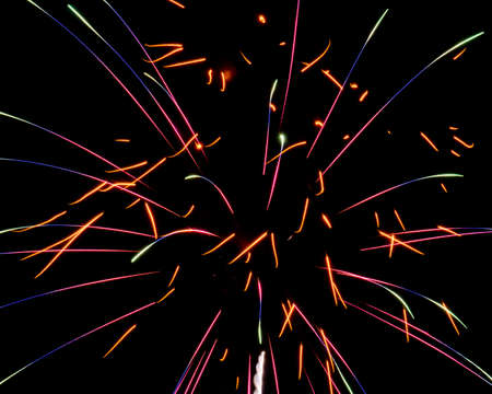 Firework Flecks and Sparks Making Light Trails in the Night Sky