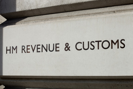 customs: A carved sign for HM Revenue & Customs, the British Tax office.