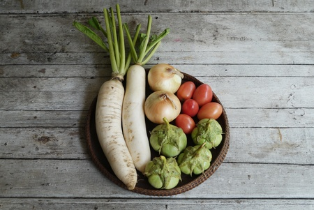 vegetables on  a wooden ,Radish, eggplant ,tomato and onions Stock Photo - 19926599