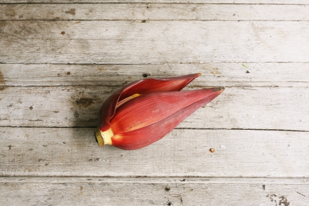 Banana blossom on wooden table photo