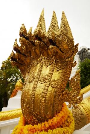 golden  seven headed serpent sculpture,Wat Phra Buddhabat,saraburi photo