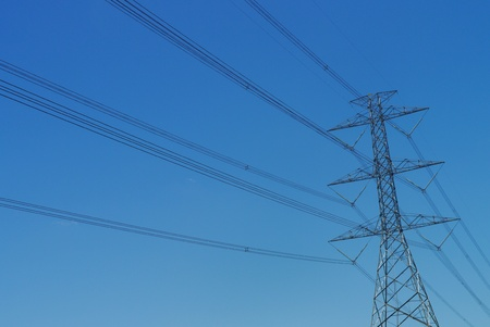 high voltage post with blue sky photo