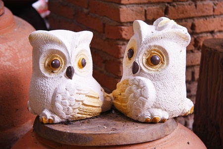 two owls baked clay ornamental in the garden photo