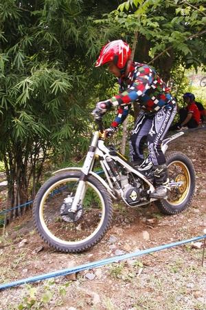 PHRA BUDDHABAT, THAILAND - AUGUST 11   Unidentified rider participates in competition Moto Trials 1,on August 11, 2013 in Phra Buddhabat, Saraburi,Thailand