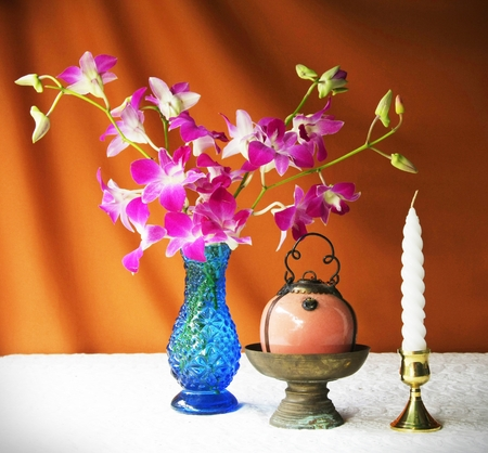 still life with vase,orchid,brass tray with pedestal,candle and Porcelain lamp   photo