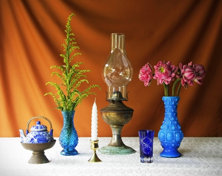 still life with lamp,earthen bowl,vase,orchid,brass tray with pedestal and candle   photo