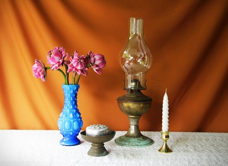 still life with vase,lotus,lamp,brass tray with pedestal,silver bowl and candle  photo
