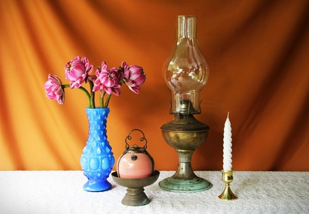 still life with vase,lotus,lamp,brass tray with pedestal and candle  photo