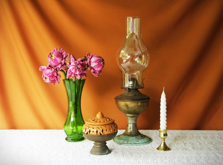 still life with vase,lotus,lamp,brass tray with pedestal,earthen bowl and candle photo