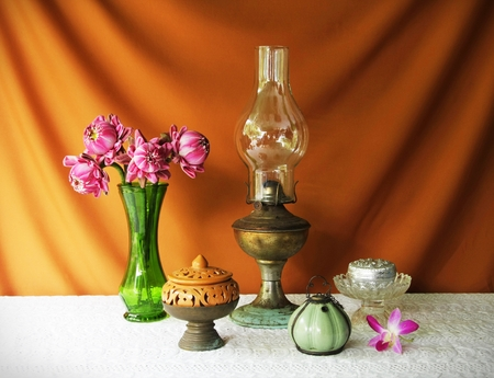 still life with vase,lotus,lamp,brass tray with pedestal,earthen bowl and silver bolw  photo