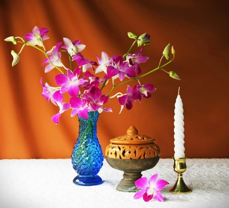 earthen bowl,vase,orchid, ash tray with pedestal and candle  photo