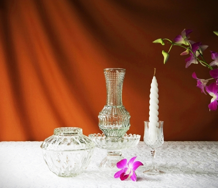 glass bowl, vase, orchid, glass tray with pedestal and candle  photo
