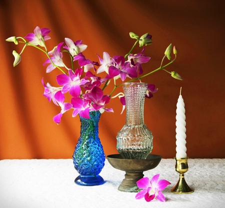 glass, vase, orchid, tray with pedestal and candle  photo