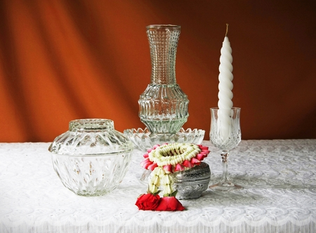 glass bowl, vase, glass tray with pedestal,candle and jasmine garland  photo