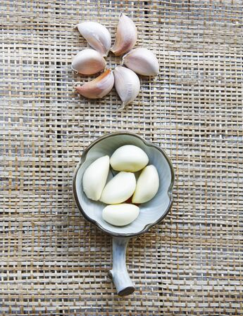 still life with garlic in a vintage bowl on the mat  photo