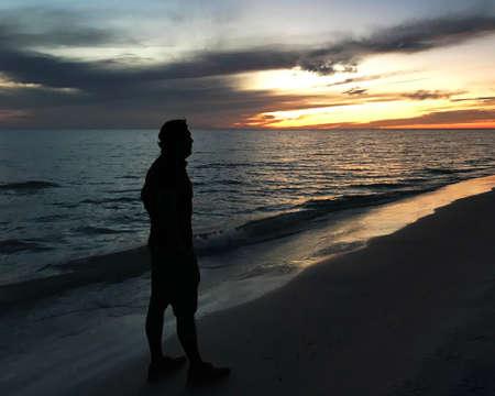 Man Watching Sunset Dusk Afternoon Beach Photo