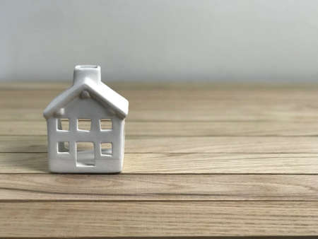 Small White House in Wood Planks photo Stock Photo