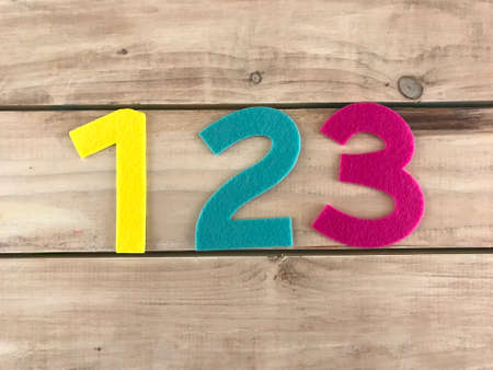 one two three numbers in wood backgrouond photo