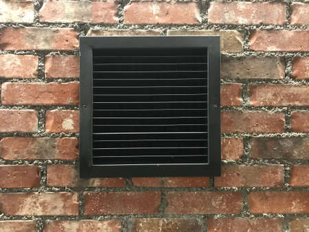Exhaust Grill Vent in brick wall Photo image Stock Photo