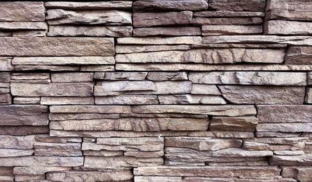 Stacked stone wall background. Photo image Reklamní fotografie