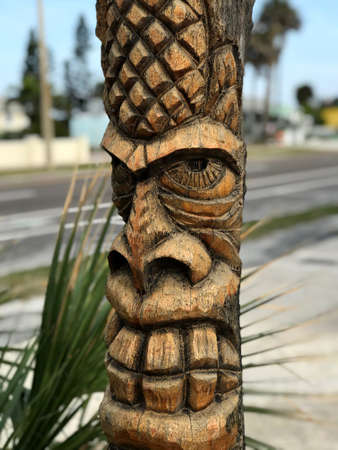 Tiki Carved Pole in Cocoa Beach . Photo image Stock Photo