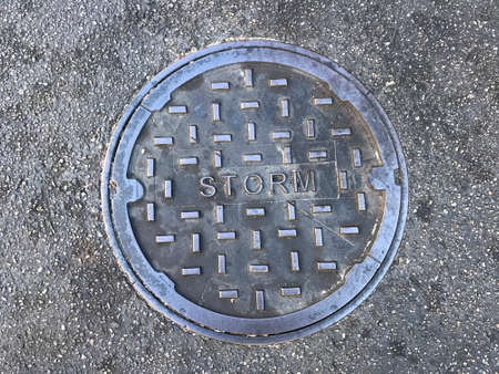 Strom metal cover in road. Photo image