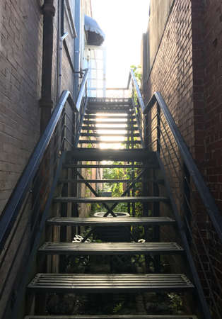 Stair for buiding access between two building walls. Photo image