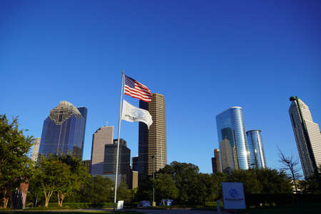 Houston, TX - October 29, 2020: Boys Girls Club Flag and USA Flag with Greater Houston Background. Photo Landscape Editöryel