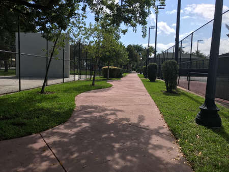 Fronton and Tennis Court in walkway Palm island Park Miami Beach. Photo image