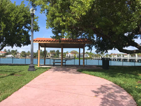 Waterfront access walkway Palm island Park Miami Beach. Photo image