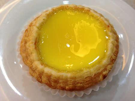 egg tart: Egg tart with fresh tart filling  Stock Photo