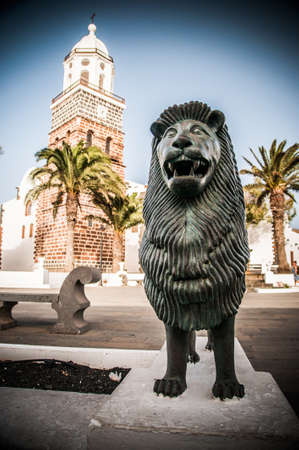 bronze lion in the square lanzarote Stock Photo