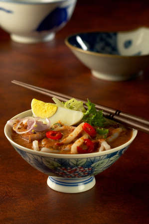 A bowl of laksa, a traditional South East Asia dish, created from the fusion of Chinese and Malay food cultures.