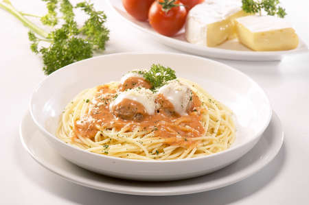 Spaghetti and meat balls with tomato sauce.